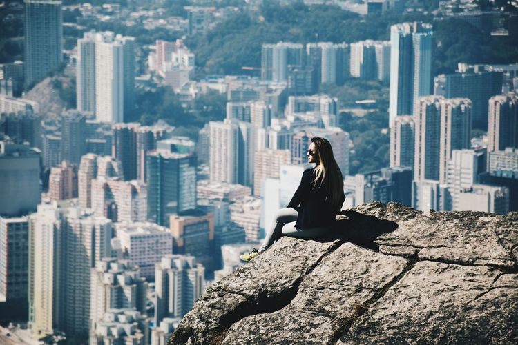 //I'm on the edge of glory// Cityscape City One Person Sitting Building Exterior Skyscraper Day Outdoors Young Adult City View From Mountain Concrete Jungle Hiking Aerial View Nikon D5500 Woman 自殺崖 Cityscape Hk HKG Females Hkgirl Mountain Top 飛鵝山 EyeEmNewHere Hong Kong Women Around The World