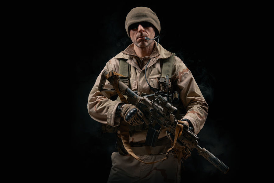 special forces soldier of the united states poses with a rifle on a black background Soldier Warrior Adult Adults Only Army Assault Rifles Black Background Camouflage Clothing Gun Headwear Men Military Night One Man Only One Person Only Men Outdoors People Rifle Special Forces Uniform War Weapon Weapons