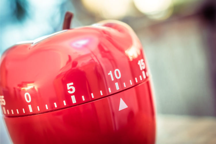 Close-up of red apple shape container on table