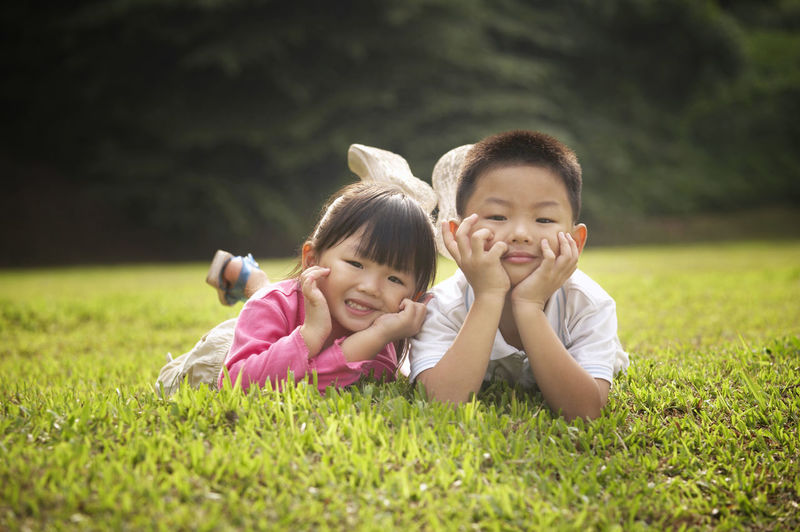 sibling playing at the park Brother Grass Hanging Out Sister Boy Child Childhood Cute Day Elementary Age Garden Girls Leisure Activity Lifestyles One Person Outdoors Park - Man Made Space Playing Real People Sibling Smiling