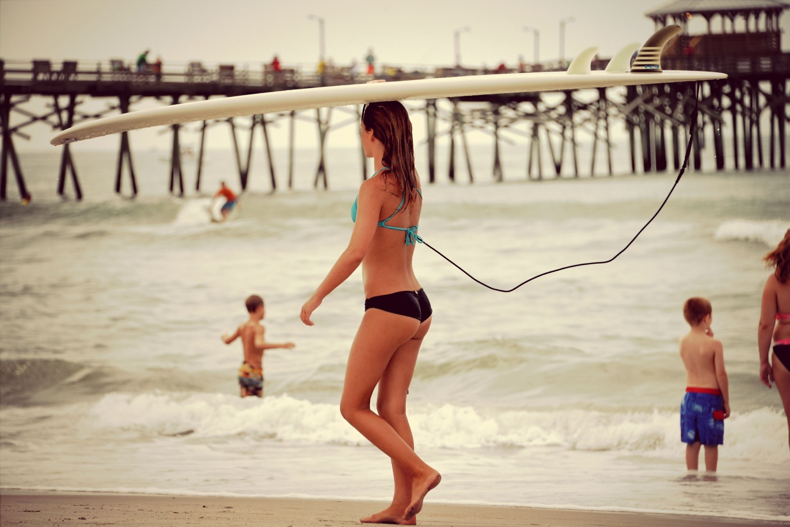 water, childhood, beach, lifestyles, sea, full length, leisure activity, enjoyment, fun, elementary age, shore, girls, boys, playful, playing, focus on foreground, happiness, sand, vacations