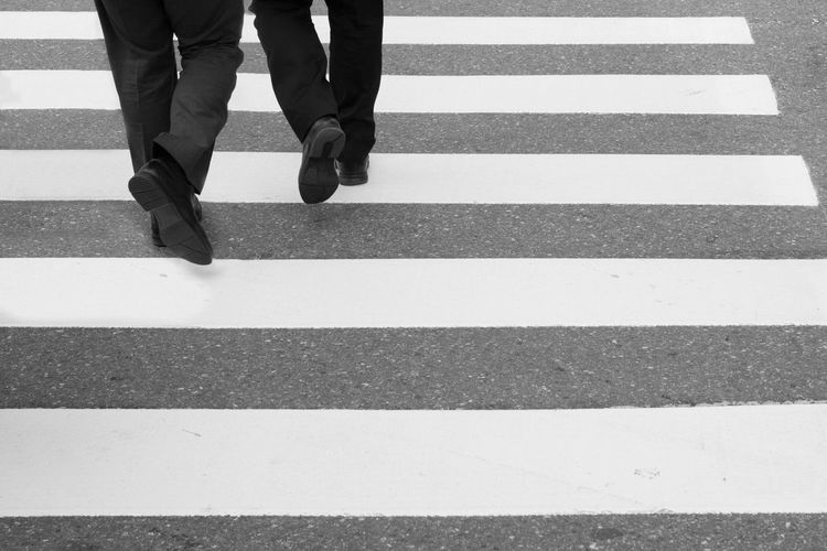 businessmen cross the street on the zebra crossing Businessmen City Human Body Part Human Leg Lifestyles Men Outdoors Pedestrian Real People Road Marking Walking Zebra Crossing EyeEm Selects