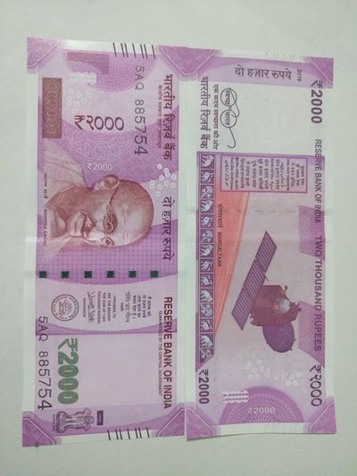 Indian two thousand rupee note 2000 Banknote Business Close-up Currency Indian Finance Finance And Economy Indian Culture  Indian Currency Indian Two Thousand Rupee Note New No People Paper Paper Currency Pink Color Savings Success Two Thousand Rupee Note Wealth