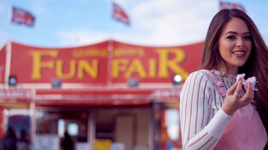 Portrait Of A Smiling Young Woman In Amusement Park