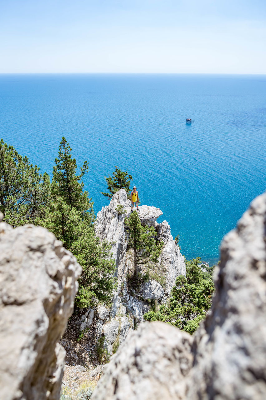 sea, water, scenics - nature, rock, beauty in nature, rock - object, tranquility, tranquil scene, solid, day, nature, sky, no people, plant, blue, horizon, land, horizon over water, high angle view, outdoors, at the edge of