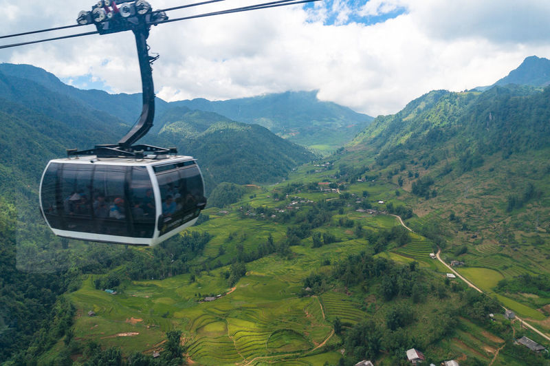 View of overhead cable car against mountains