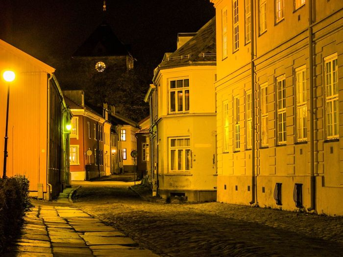 Night Architecture Illuminated Building Exterior Built Structure No People The Way Forward Outdoors Wall Lamp Norway Old Buildings Old Town House Nightphotography Night Lights Trondheim Northern Norway North Empty Road Lonely Road Welcome To Black The Graphic City