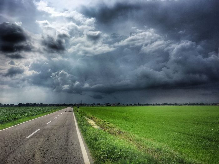 Cloud - Sky Sky Environment Road Field Landscape Land Agriculture Beauty In Nature Nature Rural Scene Direction No People Tranquility Storm