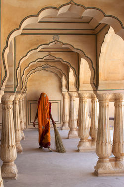 Women brushing floor at Amber Fort Jaipur Amber Fort Jaipur Architectural Column Architecture Brush Clothing Elégance Full Length One Person Sari The Past