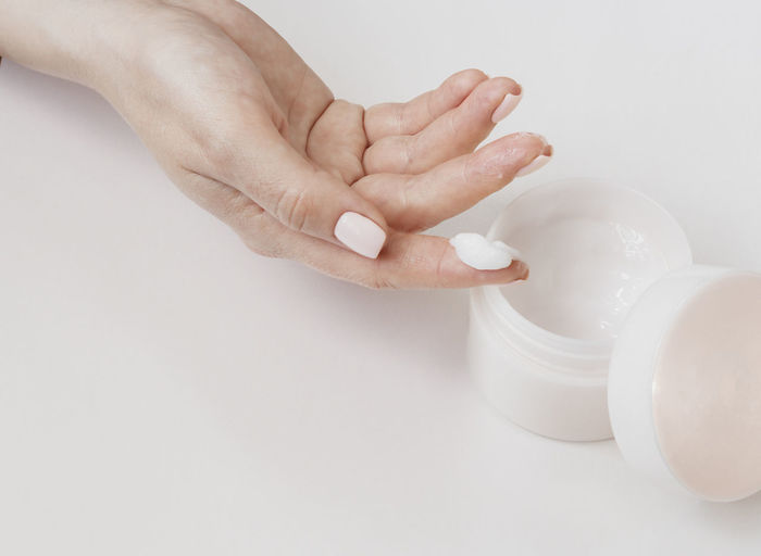 Close-up of woman hand holding white background