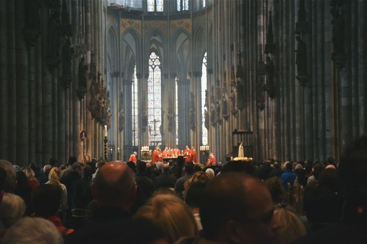 Crowd praying in cathedral