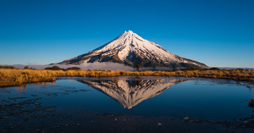 Mount Taranaki reflection at Pouakai tarns. Nature Scenic Taranaki Travel Beauty In Nature Blue Clear Sky Day Idyllic Lake Landscape Mountain New Zealand No People Outdoors Reflection Serene Snow Tranquil Scene Water