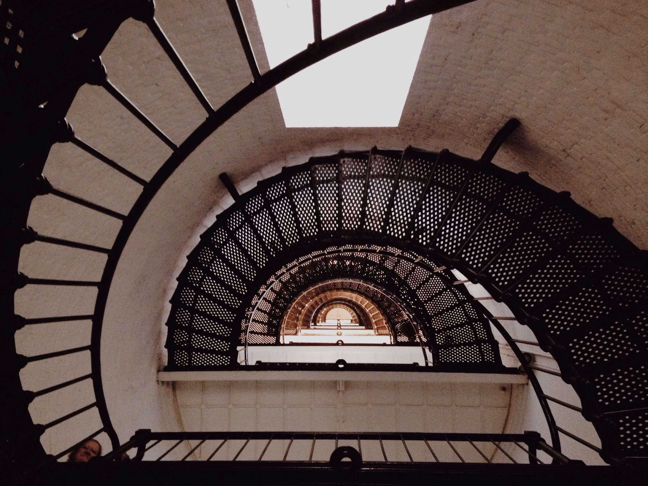 architecture, built structure, staircase, steps and staircases, indoors, steps, spiral staircase, low angle view, railing, building exterior, spiral, arch, directly below, building, stairs, pattern, ceiling, window, architectural feature, high angle view
