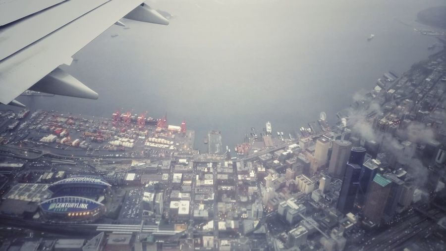 Seattle Flight Centurylinkfield Cityview Travel Destinations Downtown District Cloudy Rainy City From An Airplane Window Urban Aerial View Cityscape City Illuminated No People Night Skyscraper Outdoors Architecture Sky