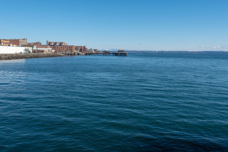 Landscape of Port Townsend, Wa dock from the water Water Waterfront Architecture Building Exterior Built Structure Sea Sky City Clear Sky No People Nature Day Blue Building Rippled Copy Space Beauty In Nature Outdoors Nautical Vessel Puget Sound Port Townsend