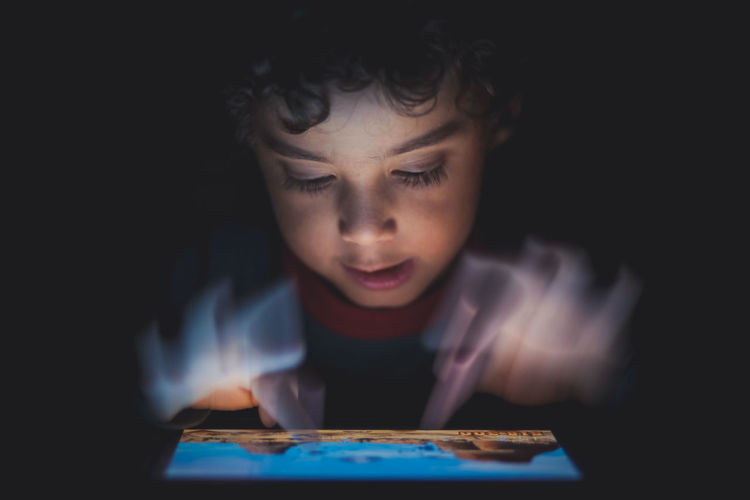 Young Boy Playing Games On Tablet