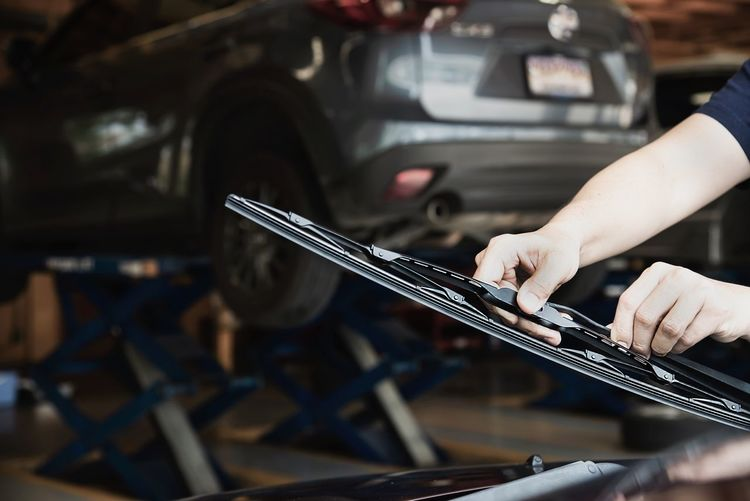 Cropped hands of man working on car