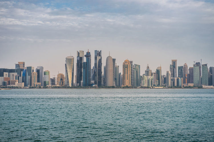 Doha skyline, Qatar, Middle East Waterfront Architecture Built Structure Water City Office Building Exterior Skyscraper Building Exterior Sky Urban Skyline Landscape Sea Cityscape Tall - High Building Modern Tower Nature Cloud - Sky No People Outdoors Financial District  Doha Qatar Westbay