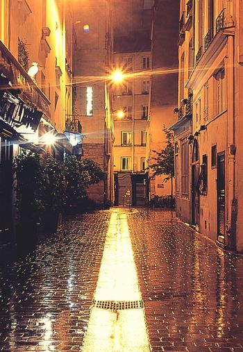 Welcome to the magical streets of Paris Street Street Light No People History Paris, France  Rain In The City Rain Paris ❤ Night Paris Mysterious City Lights City Lights At Night