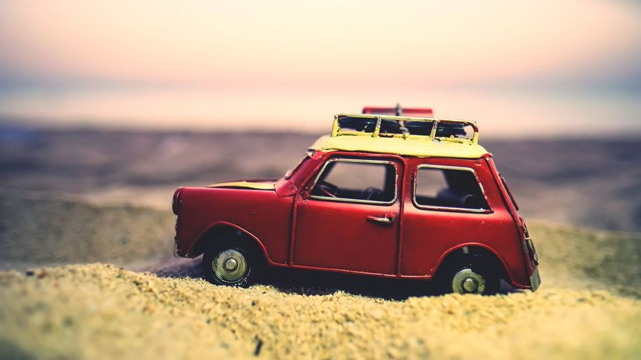 Close-up of toy car on beach