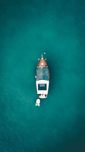 Sea Water No People High Angle View Waterfront Blue Nature Transportation Directly Above Mode Of Transportation Nautical Vessel Travel Day Outdoors Turquoise Colored Communication Beauty In Nature Architecture Built Structure Inflatable