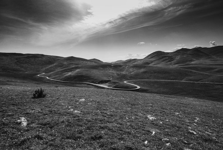 Part of Terraqua ivandimarcophotography.com Beauty In Nature Blackandwhite Campo Imperatore Country Road Day Hill Horizon Over Land Idyllic Landscape Mountain Mountain Range Nature No People Non Urban Scene Non-urban Scene Outdoors Remote Road Scenics Showcase July Sky Tranquil Scene Tranquility Wide Angle