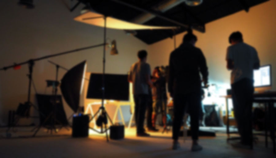 Blurred of production team shooting some video movie for tv commercial with studio equipment set. Blur Day Indoors  Men People Production Real People Studio Video; Production; Camera; Television; Film; Tv; Studio; Movie; Crew; Media; Equipment; People; Background; Set; Broadcast; Professional; Digital; Photographer; Man; Stage; Shoot; White; Work; Operator; Station; Cinema; Director; Photo; Technology; Light;