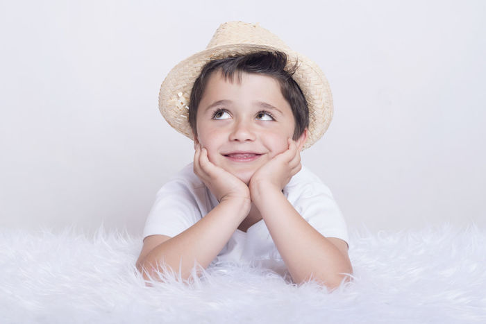 Dreaming Dreams Fun Funny Happiness Happy Imagination Intelligent Jovial Thinking Child Childhood Close-up Creative Hat Idea Joy Looking At Camera People Playful Portrait Smile Smiling Smiling Face