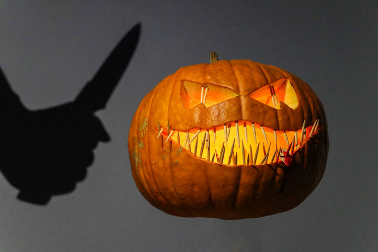 Pumpkin Food Jack O' Lantern Halloween Food And Drink Orange Color Creativity Anthropomorphic Indoors  Illuminated No People Celebration Face Anthropomorphic Face Art And Craft Close-up Craft Shadow Blood Pumpkin Seed Halloween Knife Weapon Killer Scary