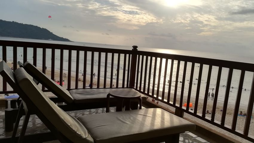 . . relaxing after a very hard day..🤣🤣 Relaxing The Week On EyeEm The Purist (no Edit, No Filter) Railing Sky Sunlight Outdoors Cloud - Sky Bridge - Man Made Structure Sun Sunset Landscape Day Water Sea Nature Chair Terrace No People