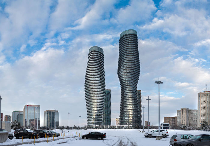 MISSISSAUGA, CANADA - DECEMBER 23, 2017: Beautiful View of the Absolute World Residential twin tower buildings in the city on a cold and snowy day Absolute Towers, Mississauga Architecture Building Building Exterior Built Structure Canada Canal Car City Cityscape Cloud - Sky Day Land Vehicle Mode Of Transportation Modern Motor Vehicle Nature No People Office Building Exterior Outdoors Sky Skyscraper Street Tall - High Transportation