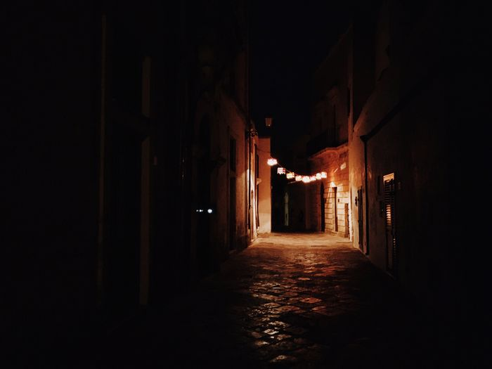 Empty narrow alley at night