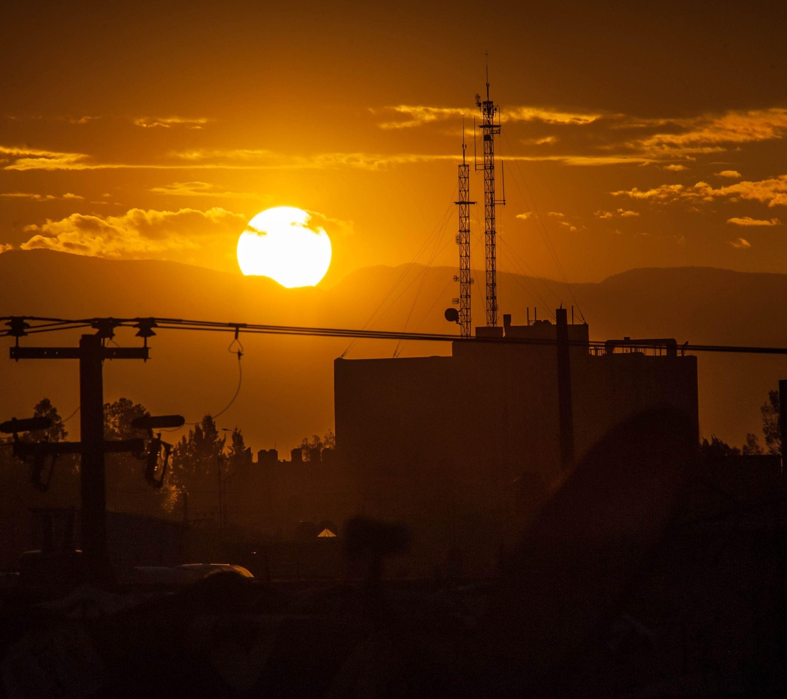 sunset, silhouette, sky, orange color, scenics, cloud - sky, beauty in nature, sun, electricity pylon, nature, water, tranquility, tranquil scene, street light, transportation, sea, power line, idyllic, connection, dusk