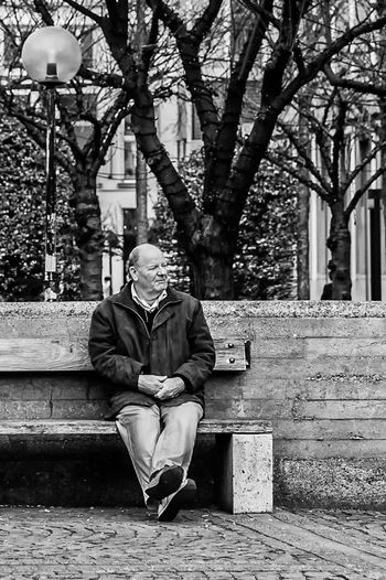 Man sitting by tree