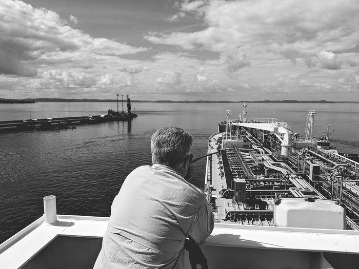 Nautical Theme Cargo Ship Life Onboard Tanker Ship Tugboat Oil Terminal Manoeuvre Water Nautical Vessel Sea Men Harbor Sky Horizon Over Water Close-up Cloud - Sky