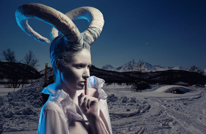 Female with goat body-art isolated on white. Dedicated to Chinese Horoscope 2015 - Year of the Goat (Sheep) Aries December Goat Horns Horoscope  Winter Woman Zodiac Sign Astrology Sign Beautiful Woman Body Paint Bodyart Character Cold Temperature Conceptual Female Finger On Lips Frozen Nature Horned Night One Person Outdoors Sheep Snow Women