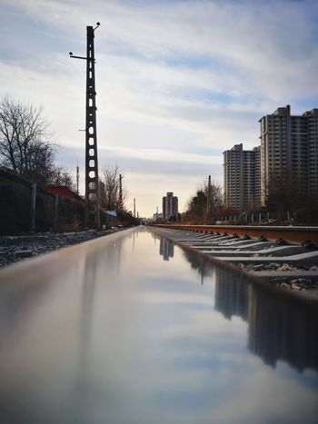 Reflection Sky Cloud - Sky City Outdoors No People Architecture Skyscraper Building Exterior Day Urban Skyline Cityscape Low Angle View Street Photography Light And Shadow Straight Transportation The Way Forward Diminishing Perspective Rail Transportation Railroad Track Mirrored Reflection Shadow Huawei P9 Photos Shadows & Lights