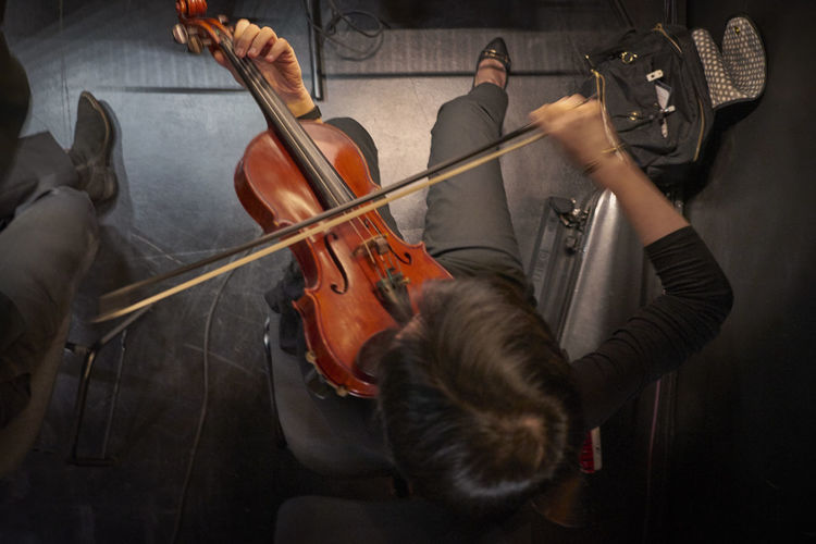 High angle view of man playing violin