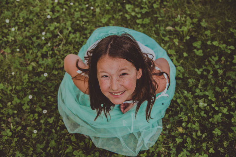 Portrait of a smiling girl on field
