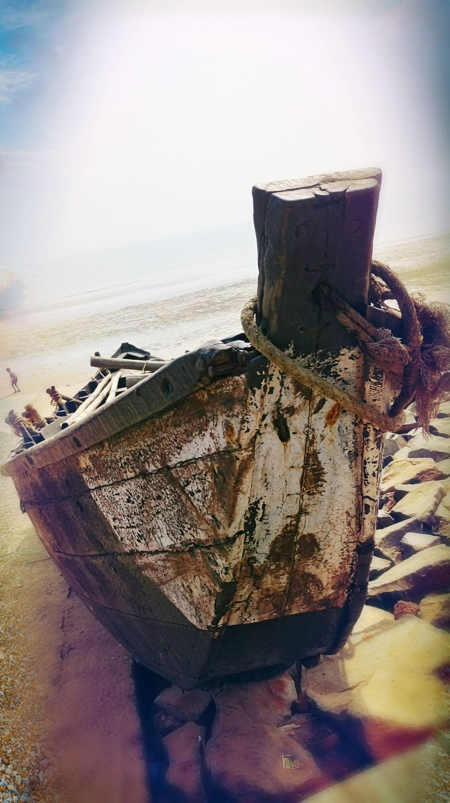 sea, beach, sky, horizon over water, water, nature, outdoors, sunlight, transportation, no people, day, mode of transport, nautical vessel, sand, scenics, tranquility, beauty in nature, rusty, close-up