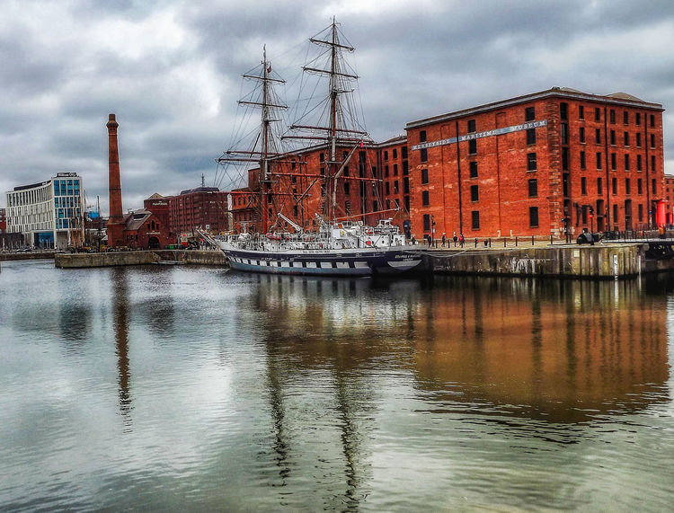 A beautiful Albert Dock Liverpool on a cloudy day Cloud - Sky Reflection Cityscape No People Architecture Tall Ship The World Through My Eyes Portrait Photography Creative Light And Shadow Malephotographerofthemonth EyeEm Masterclass Liverpool, England Fujifilm Transportation Built Structure Albert Docks Reflections In The Water Tall Ships