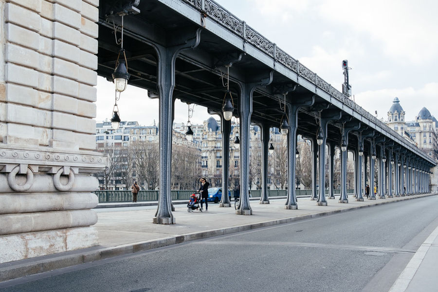 Pont de Bir-Hakeim in Paris, France Architectural Column Architecture Bir-hakeim  Bridge Bridge - Man Made Structure Building Exterior Built Structure City Connection Day Men Outdoors Paris People Pont De Bir-hakeim Real People Sky Transportation Under