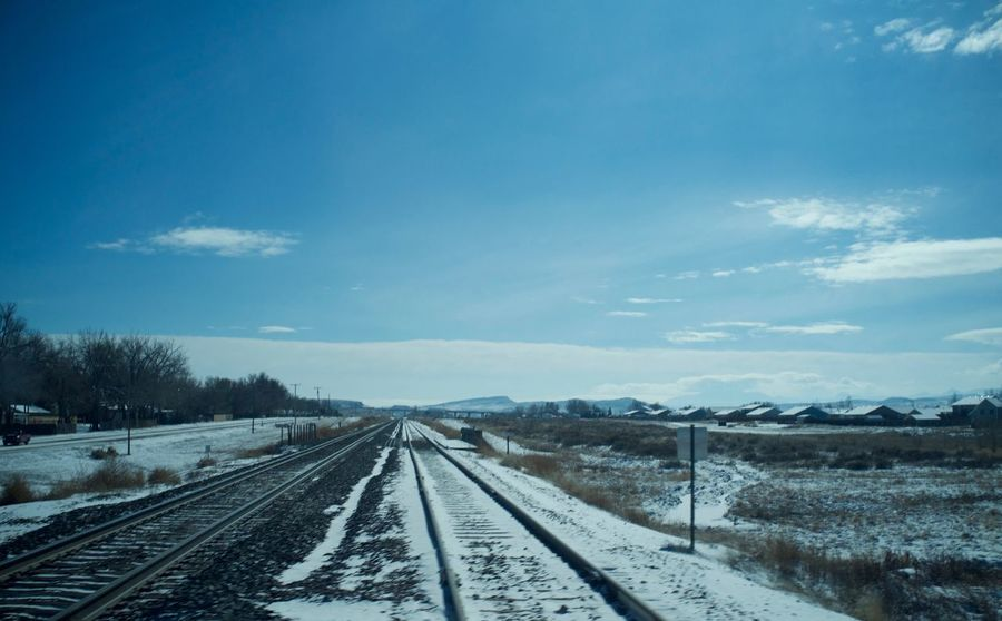 February 10, 2018 Winter Wyoming Beauty In Nature Cloud - Sky Cold Temperature Day Douglas Landscape Nature No People Outdoors Public Transportation Rail Transportation Railroad Track Railway Track Scenics Sky Snow The Way Forward Train - Vehicle Tranquil Scene Transportation Weather Winter