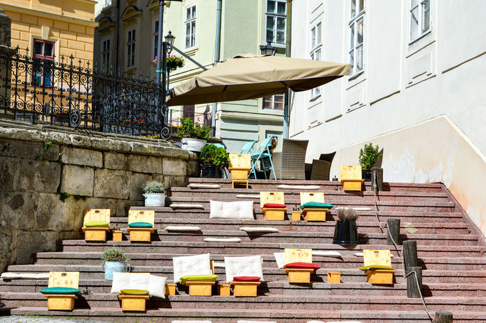 BanskáŠtiavnica Chairs Seats Streetphoto Street Life Urban Urban Lifestyle Urban Photography Urban Perspectives Built Structure Architecture Building Exterior City Low Angle View Outdoors No People Stairs Simplicity From My Point Of View EyeEm Best Shots TheWeekOnEyeEM Group Of Objects In A Row Urban Street Street Embrace Urban Life