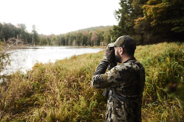 Full length of man standing by lake