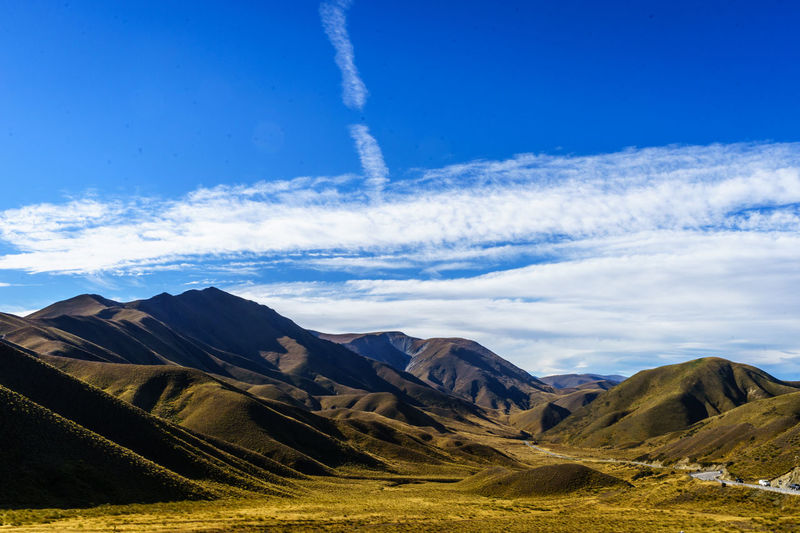 Arid Climate Beauty In Nature Blue Cloud - Sky Day Environment Formation Idyllic Land Landscape Mountain Mountain Peak Mountain Range Nature No People Non-urban Scene Outdoors Remote Scenics - Nature Sky Sunlight Tranquil Scene Tranquility