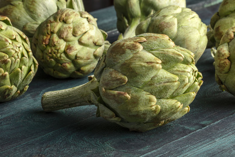 Close-up of artichoke on table