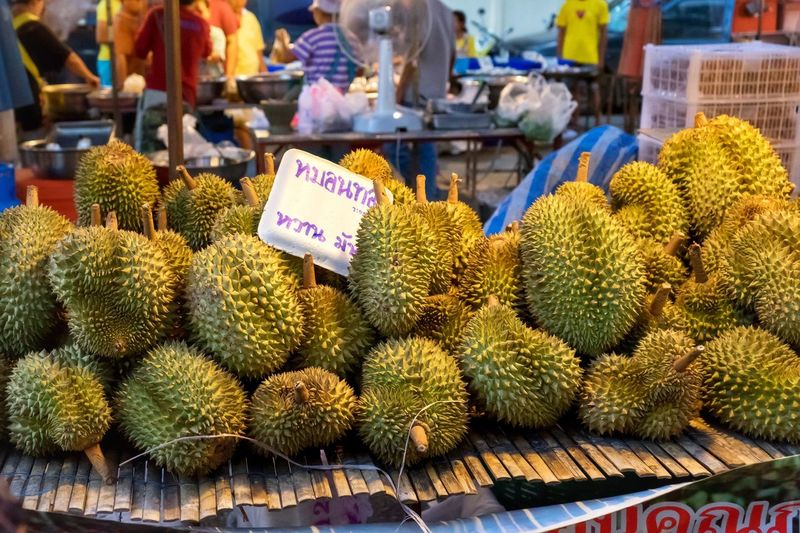 Durians for sale at market stall