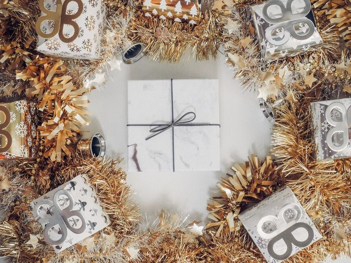Gift box with decorative items in silver and gold color. Party Celebration Event Present Gift Box No People Indoors  Design Close-up Backgrounds Christmas