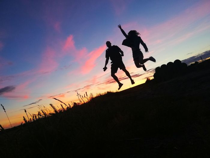 Levitate experience Gravity Sun Walking World Jumping Levitation Flying Happy Nice Tourism People person Couple Couple - Relationship Beauty In Nature Contrast Holiday Togetherness Chilling Explore Sunset Full Length Jumping Togetherness Men Silhouette Following Mid-air Sky Flight